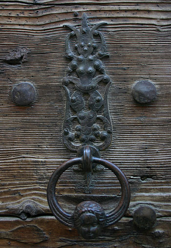 Baroque door handle at parish church in Salzburg
