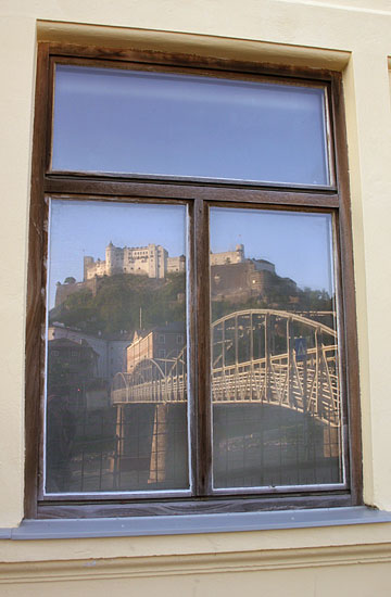 Salzburg Castle Hohensalzburg in reflection of a window