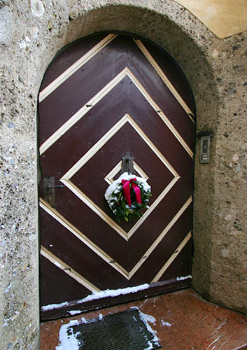 A door with festive decorations in Salzburg's old town
