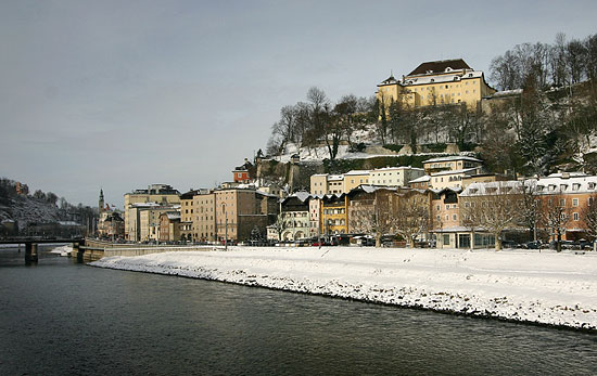 Kapuzinerkloster and the Salzach River promenade in winter